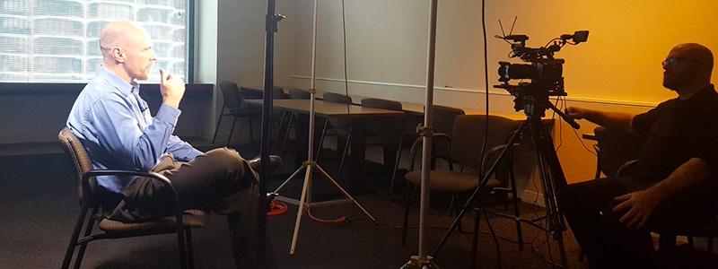 Conrad being interviewed on camera